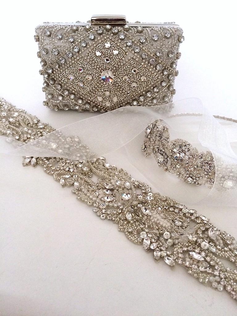 Laura Jayne bridal sash and asymmetrical bridal headband shown with a beaded clutch from Moyna Handbags.